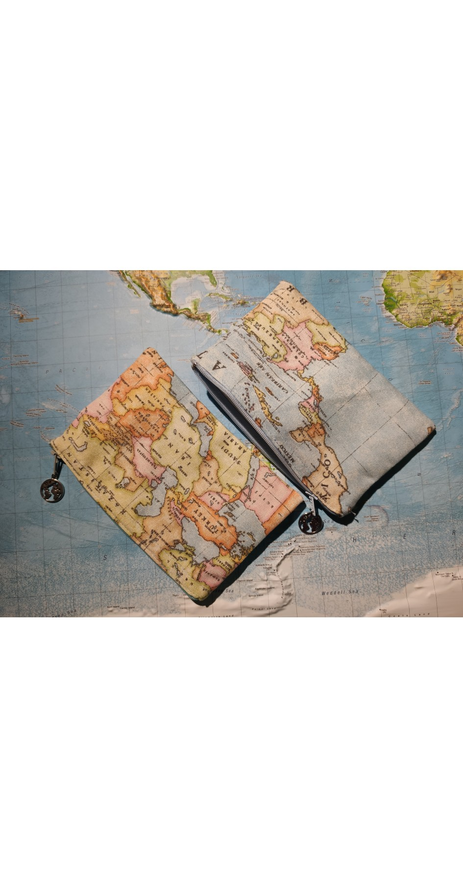 Map coin purse with globe on pull zip